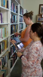 Shoppers in the MAM Resale Store Book Department